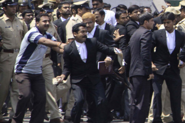 Lawyers hurling stones at the media outside city civil court in Bangalore.