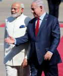 Israeli Prime Minister Benjamin Netanyahu welcomes Indian Prime Minister Narendra Modi during an official welcoming ceremony upon his arrival in Israel at Ben Gurion Airport, near Tel Aviv